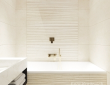 Объемное панно из натурального камня выступает в роли эффектного акцента ванной комнаты